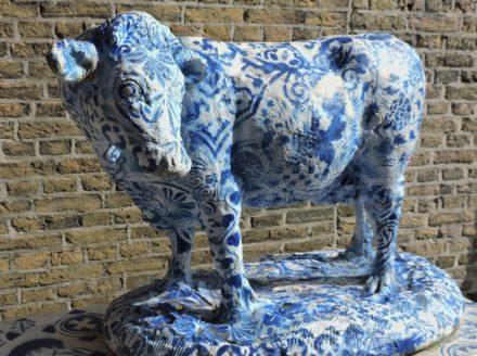 a Delft Blue cow in the city center of Delft
