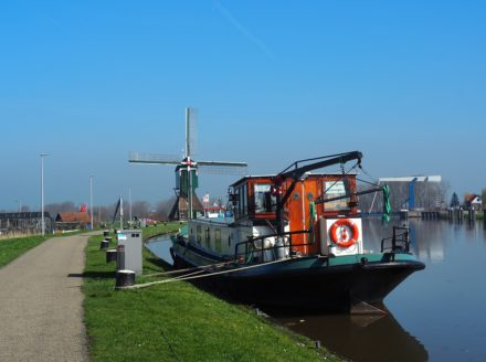 Mill and boat on a typical Ducth canal